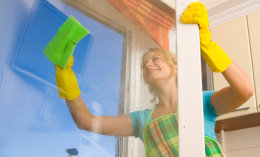 caretaker wiping window glass
